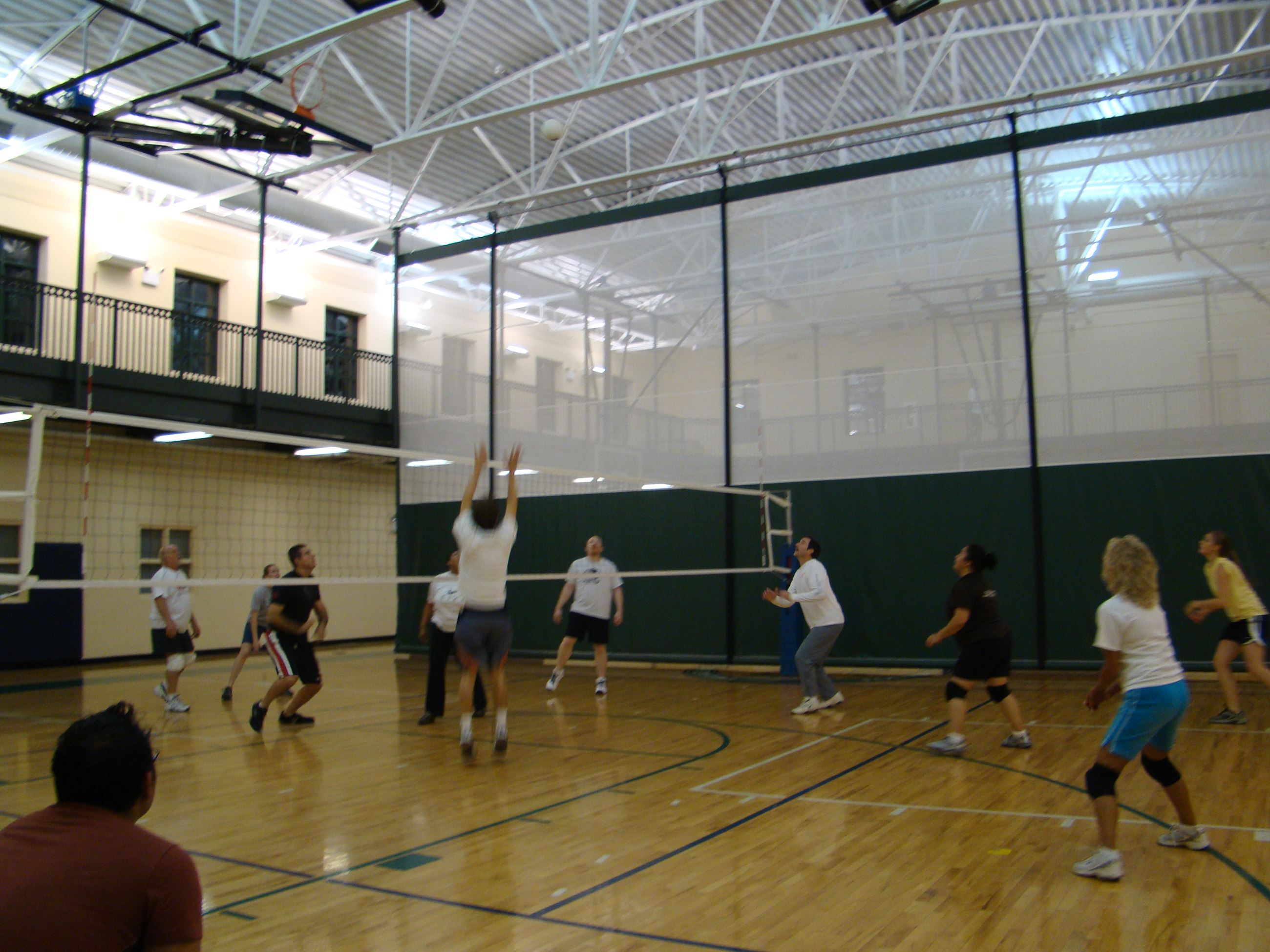 A volleyball game in progress in the Recreation Center gymnasium.