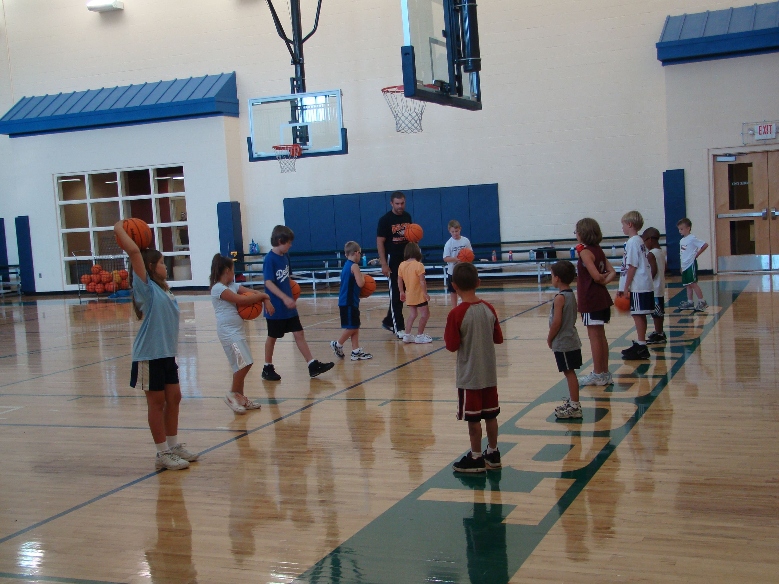 Youth practicing basketball in the Recreation Center gymnasium.